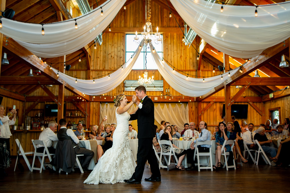 A bride and groom share their first dance at the Big Red Barn at Highland meadows wedding.